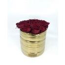 9-punast roosi kuldses keraamilises vaasis